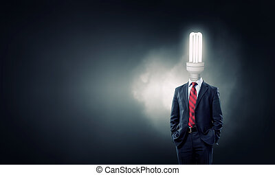 His head full of great ideas - Businessman with light...
