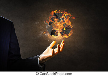 Recycling symbol in fire - Recycle sign in fire flames in...