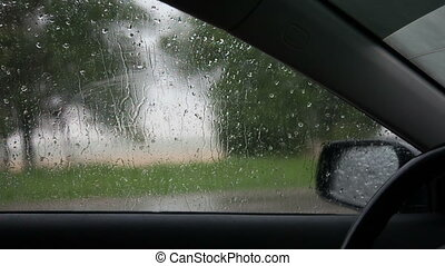 rain outside the window of the car