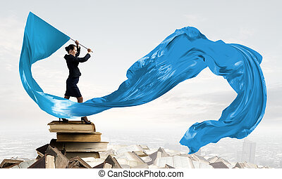 Woman waving blue flag - Young determined businesswoman with...