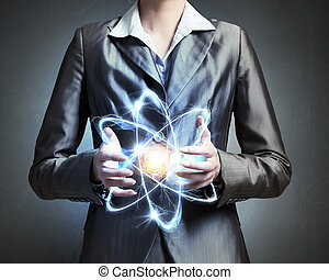 Woman scientist presenting atom research concept - Close up...