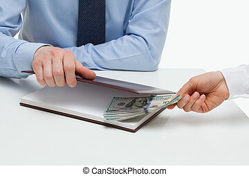 Businessman taking a bribe on workplace