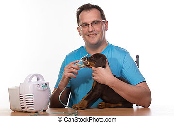 Veterinar and puppy with inhaler with inhaler - Happy adult...