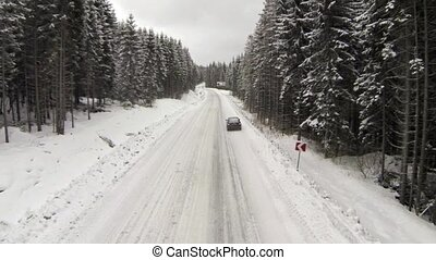 Broken car on a roadside of winter road in the Carpathian...