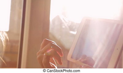 Woman using tablet, close up