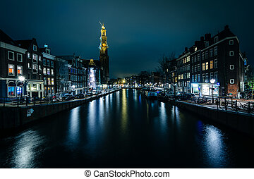 The Prinsengracht canal and Westerkerk at night, in...