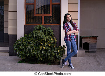 offended girl outside her house. - offended girl stands...