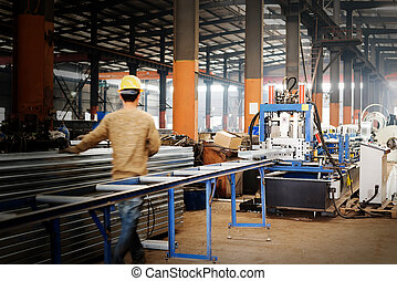 Steel plant workers at work.