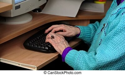 Old woman near computer