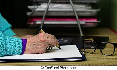 Old woman writing