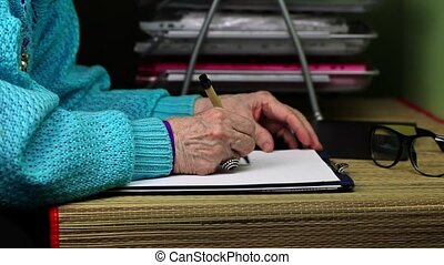 Nervous old woman writes and thrown paper