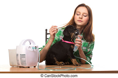 Veterinar and puppy with inhaler with inhaler - Young woman...