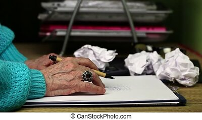 Old woman keep hand on paper