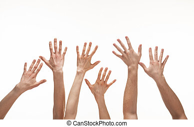 Many hands reaching out in the air