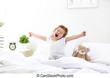 morning awakening child girl in bed