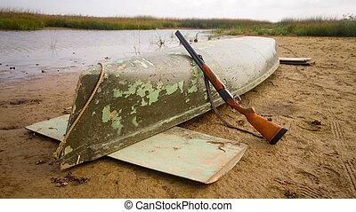 main equipment of undemanding ducks hunter - canoe and...
