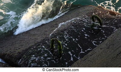 Waves beat against the rocky shore. Crimea, Russia.