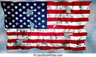 Ragged flag - Torn flag USA against the sky.
