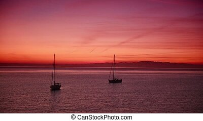 Boats on the sea - Romantic pink scene with sea boats...