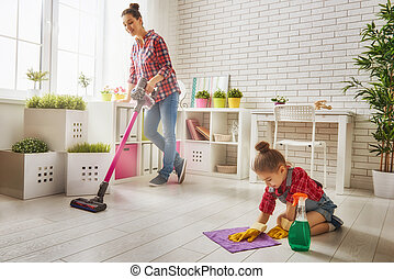 family cleans the room - Happy family cleans the room Mother...