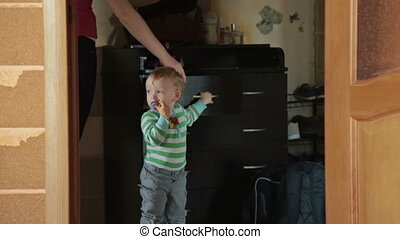 Boy stay near the chest of drawers at home - Little blondy...
