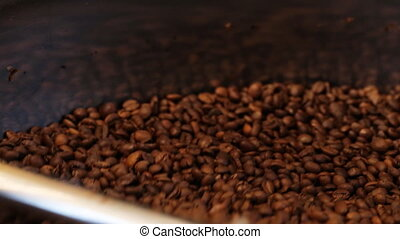 Mixing roasted coffee - traditional coffee roaster cooling...