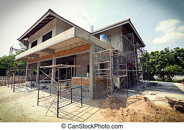building residential construction house with scaffold steel...