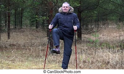 Hiker with overweight warm up in forest