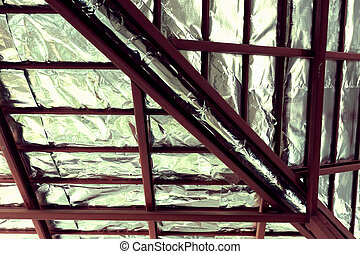 roof with steel beam and silver foil insulation heat on...