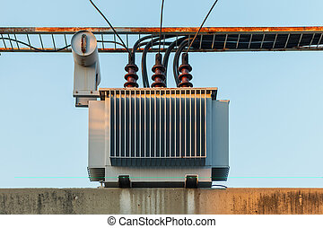 Electric transformer on pole and high-voltage lines