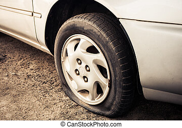 Close up Flat tire and old car on the road waiting for...