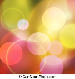 Colorful bokeh multi colored background with warm colors