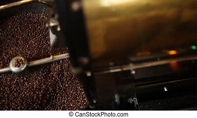 Mixing roasted coffee. - traditional coffee roaster cooling...
