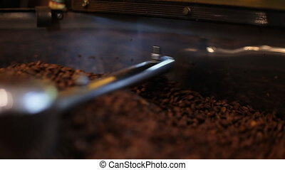 Coffee beans after roasting - traditional coffee roaster...