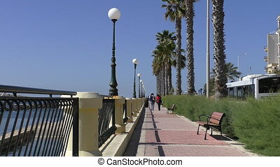 Promenade with palm trees in Malta - Malta island.People...