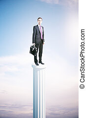 Businessman on pedestal