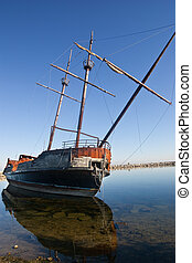 Abandoned old pirate ship - An old abandoned pirate ship,...