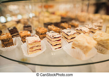Different delicious desserts and cakes on the buffet table