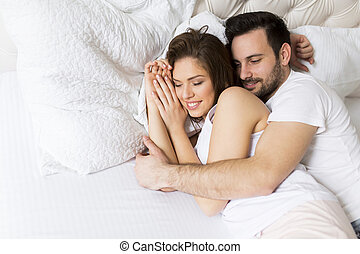Loving couple in the bed