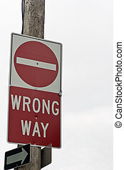 Wrong way sign on hydro pole - A wrong way sign on a hydro...