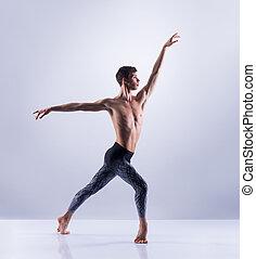 Athletic ballet dancer performing in a studio - Athletic...