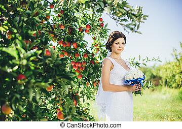 Bride in the apple garden