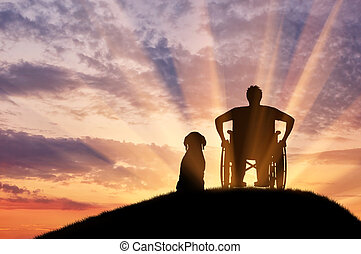 Silhouette of disabled and dog - Concept of disability and...