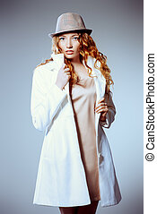 lady in white coat - Sexual female model with curly foxy...
