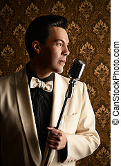 singer with microphone - Handsome male singer, who plays in...