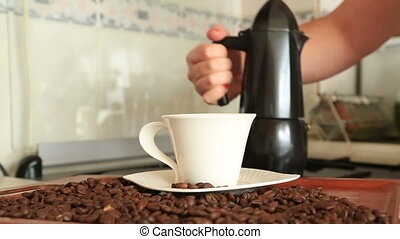 Hand hold moka pot fill the coffee - Classic italian coffee...