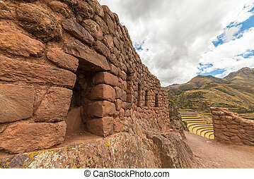 Inca terraces and walls in Pisac, Sacred Valley, Peru - Wide...