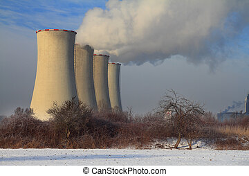 Power plant - The steam from the cooling towers of power...