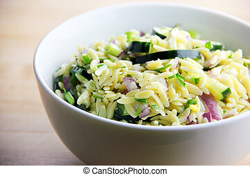 Orzo Salad - A bowl of homemade orzo salad with cucumber,...