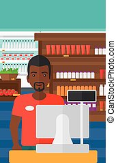 Salesman standing at checkout - An african-american salesman...